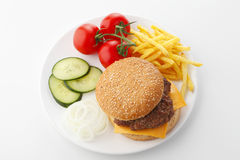 Beef Cheese Hamburger with French Fries. Lettuce, tomato, onion, cucumber, ketchup and mayonnaise on white background. View from above Stock Photos
