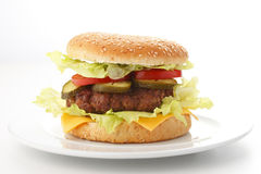 Beef Cheese Hamburger. With lettuce, tomato, onion, cucumber, ketchup and mayonnaise, isolated on white Royalty Free Stock Photos