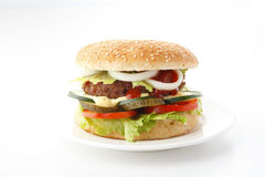 Beef Cheese Hamburger. With lettuce, tomato, onion, cucumber, ketchup and mayonnaise,  on white Royalty Free Stock Photography