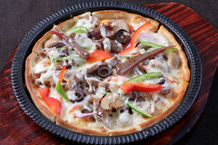 Beef cheese pizza. Pizza cheese iron pan yummy eat food meat beef stock photo