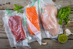 Beef, chicken and salmon in vacuum plastic bag for sous vide cooking Royalty Free Stock Photo