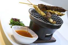 Beef & Chicken Satay with Peanut Sauce. Traditional preparation of beef & chicken satay served with peanut sauce Stock Photos