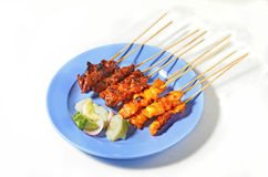 Beef and chicken satay. On a plate Royalty Free Stock Photos