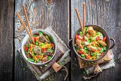 Beef, chicken in sesame seeds with noodles and vegetables Stock Photography