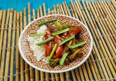 Beef chilli flash fry. Goan  Beef chilli flash fry with yoghurt rice , close up Royalty Free Stock Image