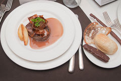 Beef in chocolate sauce with vegetables on a plate and chocolate Royalty Free Stock Photo