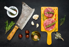 Beef Chops with Meat Cleaver and Cooking Ingredients Royalty Free Stock Images
