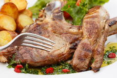 Beef chops with potatoes and salad Royalty Free Stock Image