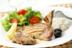 Beef chops with rice and salad Stock Images