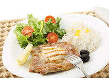 Beef chops with rice and salad isolated on white. (top Stock Image