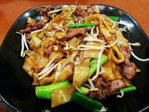 Beef chow fun (Dry-fried beef hor fun). Beef chow fun is a staple Cantonese dish, made from stir-frying beef, hor fun & x28;wide rice noodles& x29; and Stock Images