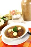 Beef Consomme. A bowl of Beef consomm� with Royal and parsley Royalty Free Stock Photos