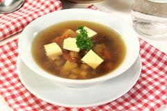 Beef Consomme. A bowl of Beef consomm� with Royal and parsley Royalty Free Stock Image