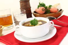 Beef consomme. With greens, egg and parsley Stock Photo