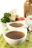 Beef Consomme. Two cups of Beef consomm� on a napkin Stock Photos