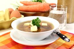 Beef Consomme. A bowl of Beef consomm� with Royal and parsley Stock Photography