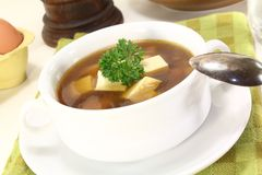 Beef consomme with egg. Beef consomme with greens, egg and fresh parsley Stock Photo
