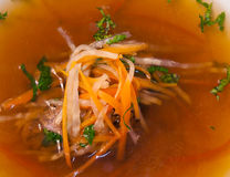 Beef consomme with root vegetables and meat. Beef soup with vegetables and meat Royalty Free Stock Photos