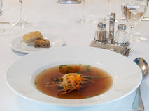 Beef consomme with root vegetables and meat. Beef soup with vegetables and meat Stock Image