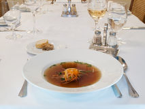 Beef consomme with vegetables. Beef soup with vegetables and meat Stock Image