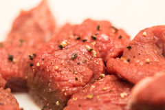 Beef cubes. Raw beef cubes seasoned with salt and pepper Royalty Free Stock Images