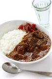 Beef curry on rice. Japanese most popular curry on a white background Royalty Free Stock Photography