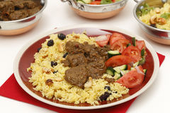Beef curry with serving bowls Royalty Free Stock Photos