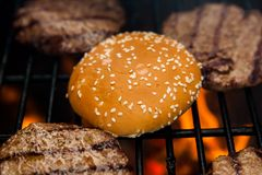 Beef cutlet on grill with bun Stock Photos