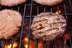 Beef cutlet on grill Royalty Free Stock Images