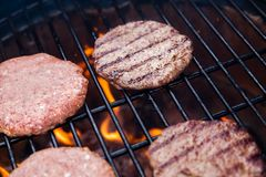 Beef cutlet on grill Stock Photography