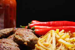 Beef cutlets with french fries Royalty Free Stock Photos