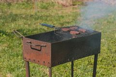 Beef cutlets on the grill brazier. Close-up. stock images