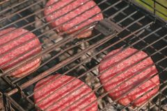 Beef cutlets on the grill. Close-up. stock photo