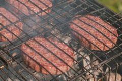Beef cutlets on the grill. Close-up. Beef cutlets on the grill. Close-up outdoor royalty free stock images