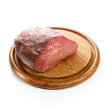 Beef on cutting board Stock Images