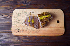 Beef. On the cutting board with french mustard Royalty Free Stock Images