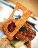 Beef Diana. W/ Mushroom Sauce And Crispy Pangsit Stock Photo