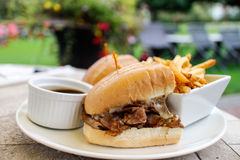 Beef dip with french fries Stock Photos