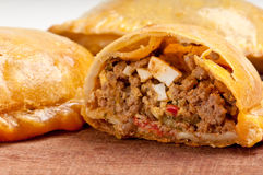 Beef empanada close-up. Beef Empanada fill close up.  The Empanada is a pastry turnover filled with a variety of savory ingredients and baked or fried Stock Photo
