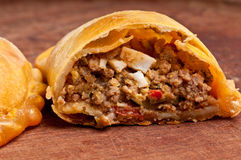 Beef empanada fill. Close up.  The Empanada is a pastry turnover filled with a variety of savory ingredients and baked or fried Stock Photos