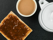 Beef Extract Spread on Toast. Against a Black Background stock image