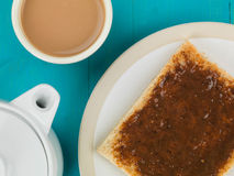 Beef Extract Spread on Toast. Against a Blue Wooden Background royalty free stock images