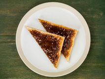 Beef Extract Spread on Toast. Against a Green Wooden Background royalty free stock photos