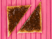 Beef Extract Spread on Toast. Against a Pink Wooden Background stock image