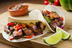 Beef Fajitas. With peppers, red onion, cilantro, ranchero sauce, and lime Stock Image