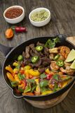 Beef Fajitas In Cast Iron Skillet royalty free stock photography