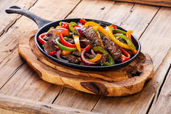 Beef Fajitas. With colorful bell peppers in cast iron pan Stock Photography