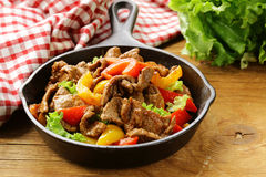 Beef Fajitas with colorful bell peppers in pan royalty free stock photos