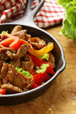 Beef Fajitas with colorful bell peppers in pan Royalty Free Stock Image