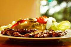 Beef fajitas with salad. Beef fajitas on a white plate with salad Stock Photos